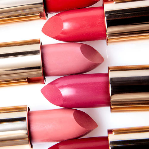 Close up of different shades of pink and red lipsticks